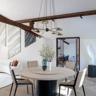 Photo of a contemporary open plan dining room in Other with white walls, medium hardwood flooring, no fireplace, brown floors and exposed beams.