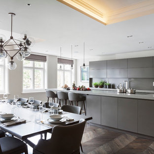 Photo of a large contemporary kitchen/dining room in London with dark hardwood flooring.