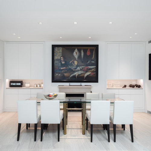 Small Modern Dining Room In London With White Walls And Beige Floors