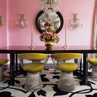 Inspiration for an eclectic dining room remodel in Other with pink walls