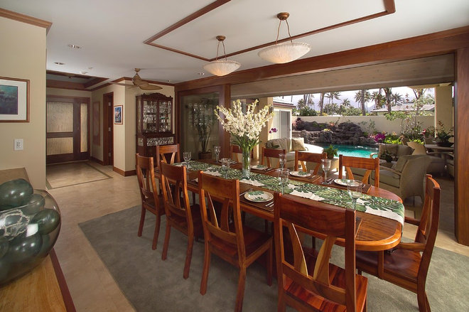 Tropical Dining Room by Archipelago Hawaii Luxury Home Designs