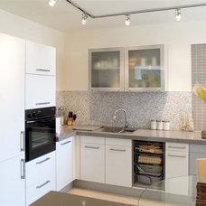 Modern Dining Room by Asher Elbaz