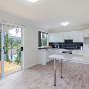 Mid-sized urban laminate floor and beige floor great room photo in Newcastle - Maitland with beige walls