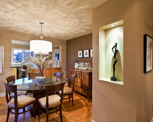 Trendy Dining Room Photo In Vancouver With Brown Walls And Medium Tone Wood  Floors