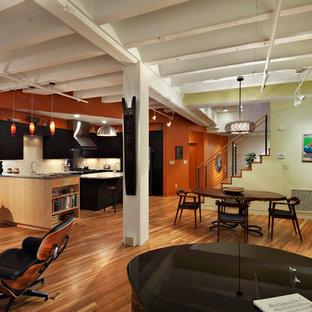 Esempio di una sala da pranzo aperta verso il soggiorno design con pareti verdi
