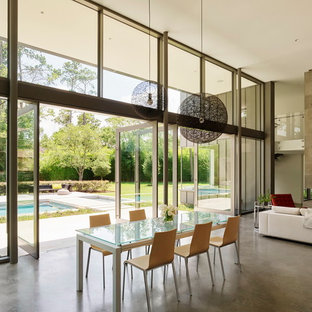 Great room - modern concrete floor and gray floor great room idea in Houston with white walls