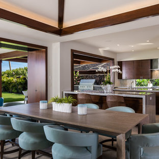 Inspiration for a tropical kitchen/dining combo in Other with grey floor.