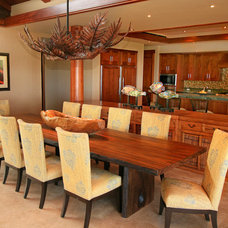 Tropical Dining Room by Fine Design Interiors, Inc
