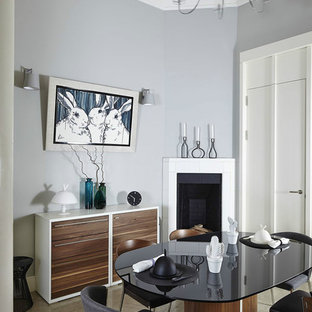 Inspiration for a contemporary dining room remodel in Moscow with gray walls and a corner fireplace
