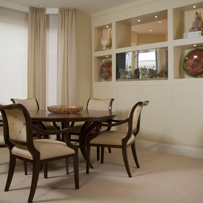 Mid-sized trendy carpeted enclosed dining room photo in San Diego with beige walls