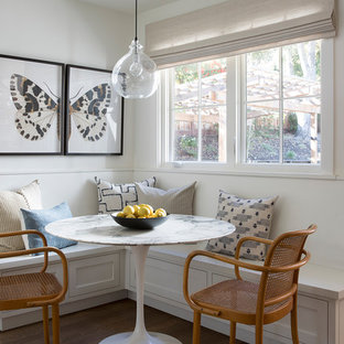 Inspiration for a mid-sized transitional brown floor and medium tone wood floor kitchen/dining room combo remodel in San Francisco with white walls