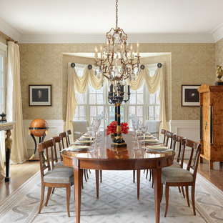 Design ideas for a large classic enclosed dining room in St Louis with yellow walls and medium hardwood flooring.