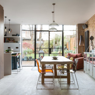 Design ideas for a large bohemian open plan dining room in London with light hardwood flooring and no fireplace.