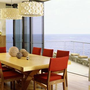 Example of a minimalist medium tone wood floor dining room design in Orange County with beige walls