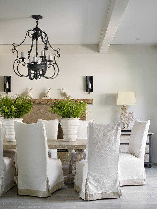 example of a light wood floor dining room design in atlanta with white walls