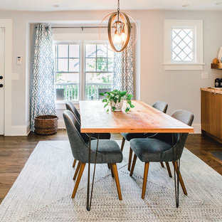 Kitchen/dining room combo - mid-sized transitional dark wood floor and brown floor kitchen/dining room combo idea in Atlanta with white walls, a standard fireplace and a tile fireplace