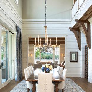 Ispirazione per una sala da pranzo chic con pareti bianche, pavimento in legno massello medio e nessun camino