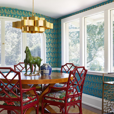 Example of a mid-sized eclectic dark wood floor and brown floor enclosed dining room design in Minneapolis with blue walls and no fireplace