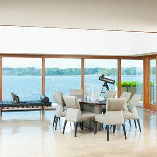 ダラスの広いミッドセンチュリースタイルのおしゃれなLDK (ベージュの壁、コンクリートの床、標準型暖炉、レンガの暖炉まわり、グレーの床) の写真