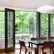Contemporary Dining Room by RhDesign