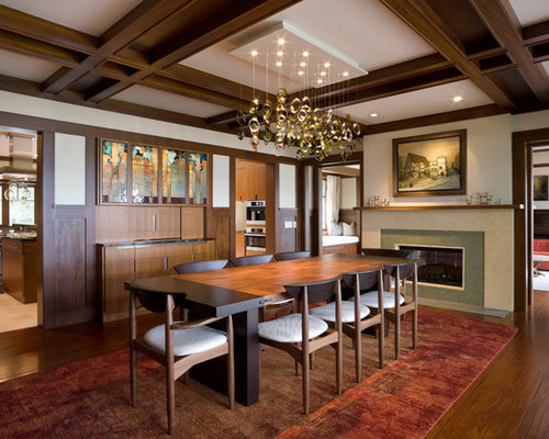 Example Of A Transitional Dark Wood Floor Dining Room Design In Chicago  With White Walls And