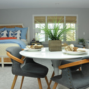 Inspiration for a mid-sized beach style open plan dining in Grand Rapids with grey walls, carpet and grey floor.