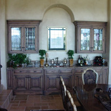 Mediterranean Dining Room by Eagle Designs and Woodworking, Inc.