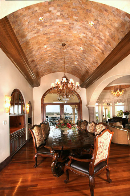 Mediterranean Dining Room by Zbranek & Holt Custom Homes