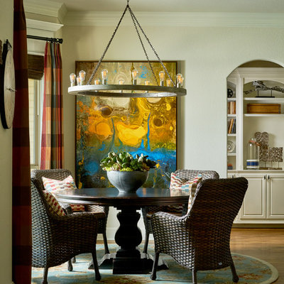 Example of a large transitional medium tone wood floor and brown floor enclosed dining room design in Other with beige walls and no fireplace