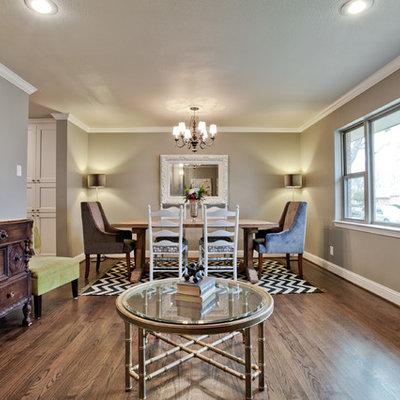 Example of a trendy dark wood floor dining room design in Dallas with beige walls