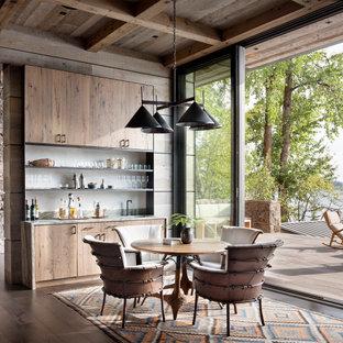 Foto de comedor rústico, de tamaño medio, abierto, con suelo de madera oscura, paredes marrones y suelo marrón