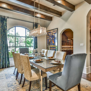 Inspiration for a mediterranean medium tone wood floor and brown floor dining room remodel in Houston with beige walls and no fireplace