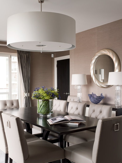 Example Of A Large Transitional Enclosed Dining Room Design In London With Beige Walls