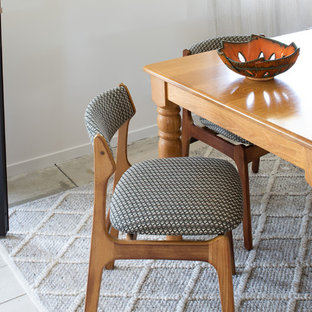 Inspiration for a mid-sized scandinavian ceramic floor and beige floor dining room remodel in Other with white walls