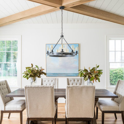 Enclosed dining room - transitional light wood floor and beige floor enclosed dining room idea in Atlanta with white walls and no fireplace