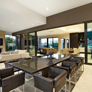 This is an example of a contemporary open plan dining in Melbourne with brown walls.