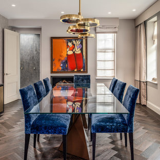 This is an example of an eclectic dining room in London.