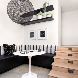 Inspiration for a mid-sized contemporary concrete floor and beige floor great room remodel in Los Angeles with white walls