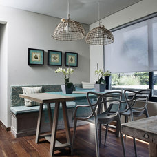 Contemporary Dining Room by MARIANGEL COGHLAN