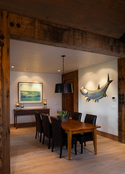 Rustic Dining Room by Dovetail Construction