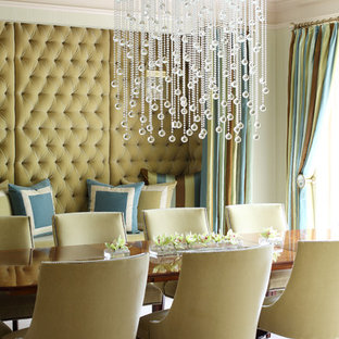 Example of a mid-sized trendy enclosed dining room design in Little Rock with green walls and no fireplace