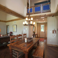 Rustic Dining Room by Turnstone Builders, LLC