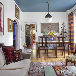 Example of a southwest light wood floor and brown floor dining room design in Denver with white walls