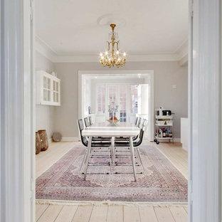 Large danish light wood floor and beige floor dining room photo in Odense