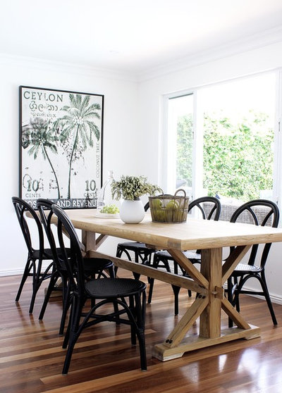 Beach Style Dining Room by Kathryn Bloomer Interiors