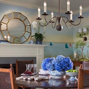 Ejemplo de comedor marinero, de tamaño medio, cerrado, con paredes azules, suelo de madera oscura, chimenea tradicional y marco de chimenea de madera