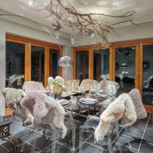 Photo of a medium sized eclectic enclosed dining room in Other with beige walls and grey floors.