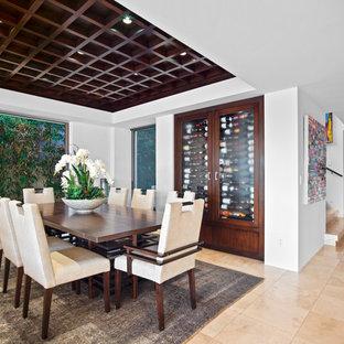 Foto de comedor tropical, sin chimenea, con paredes blancas y suelo beige