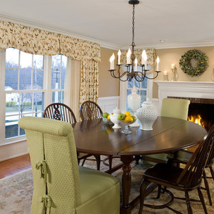 Enclosed dining room - mid-sized traditional medium tone wood floor enclosed dining room idea in Philadelphia with beige walls, a standard fireplace and a brick fireplace
