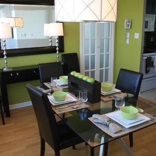 Dining room - contemporary medium tone wood floor dining room idea in Toronto with green walls
